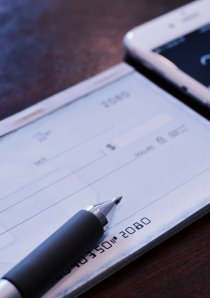 a checkbook with a personal check for apartment security deposit