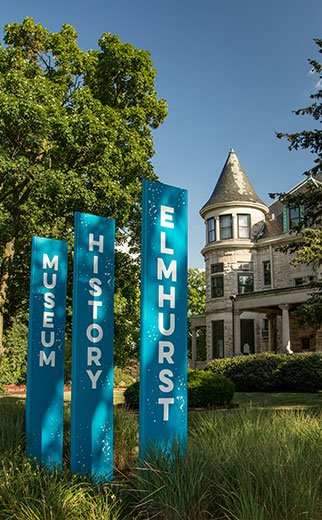 banner signs in front of historic white house in the Chicago suburb of Elmhurst Illinois