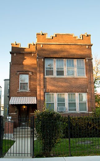 exterior of brick apartment building in Hermosa Chicago