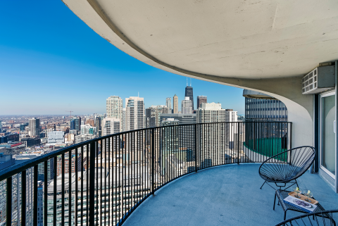 concrete balcony  of Chicago condo for rent with panoramic view of downtown Chicago skyline