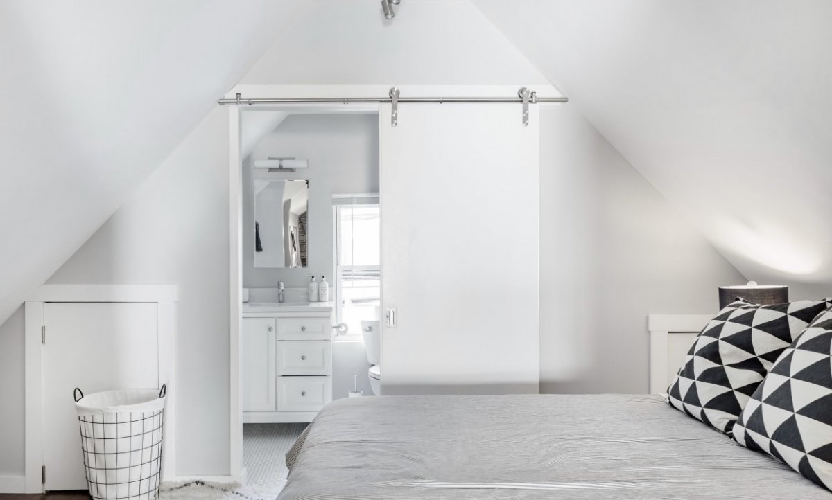 apartment bedroom with sliding door open to en suite bathroom