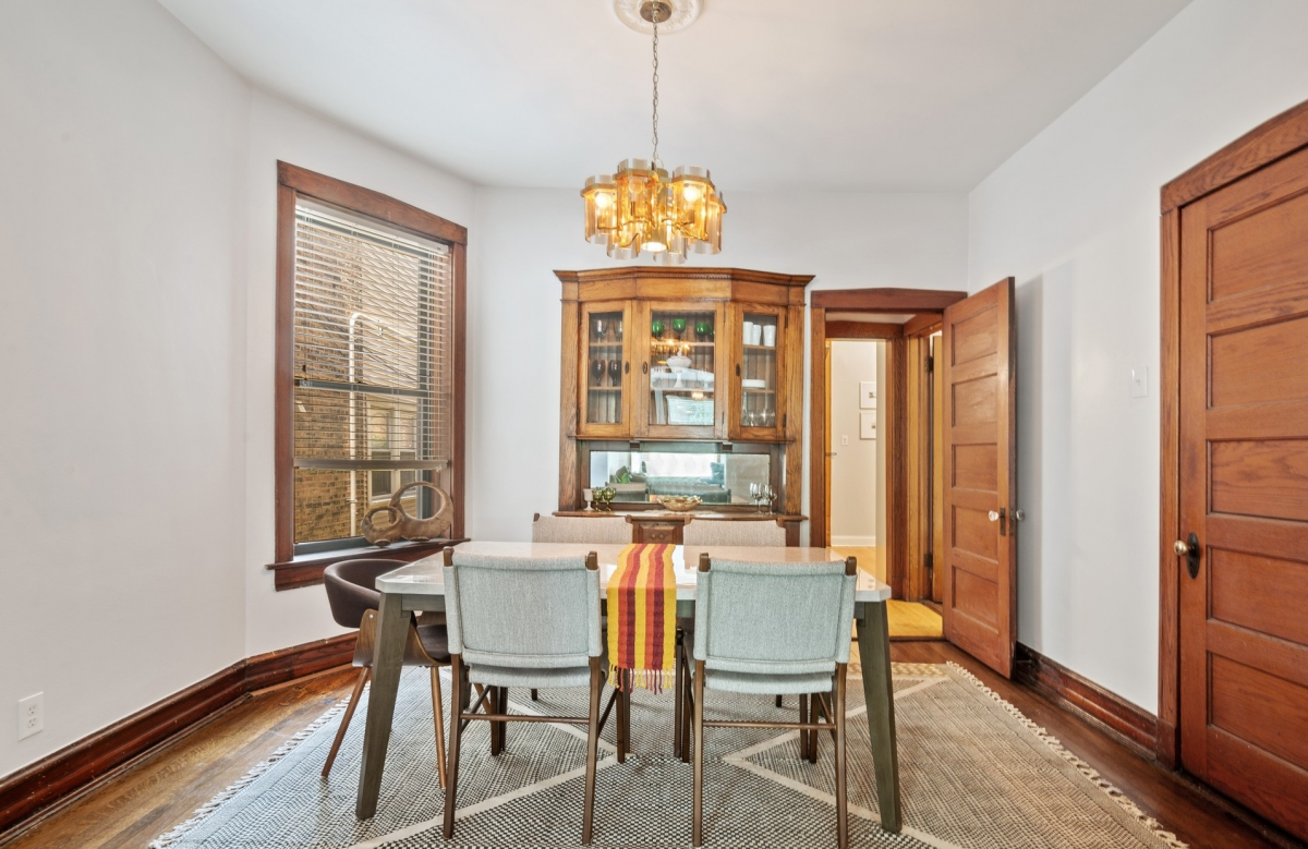 dining table and built-in cabinets in dining room of vintage apartment for rent in Chicago