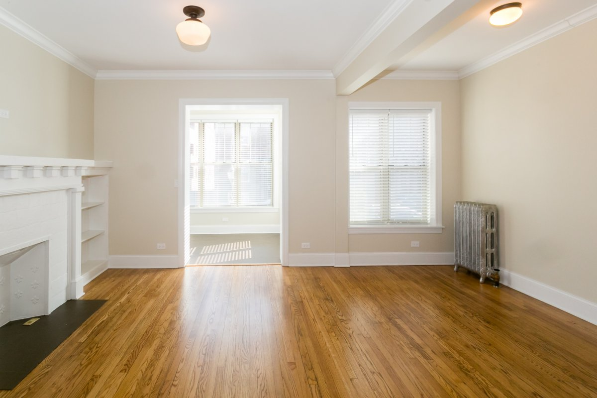 Chicago apartment with hardwood flooring and ornamental fireplace