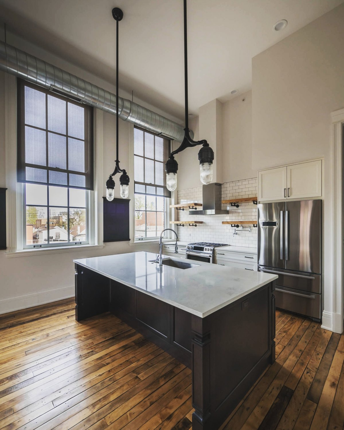 Chicago lof apartment with custom kitchen island topped with marble stone counters