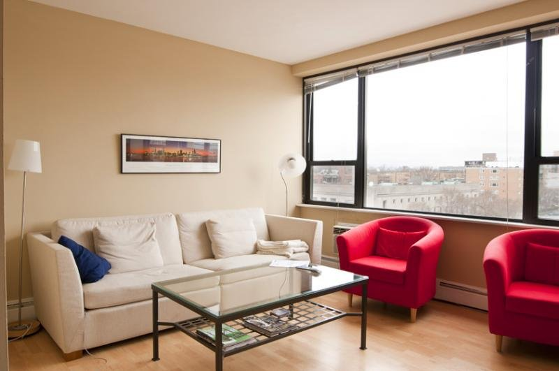living rom with view from windows at 1575 Oak Apartments in Evanston IL