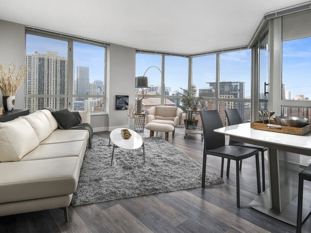 furnished model living room at One East Delaware Apartments
