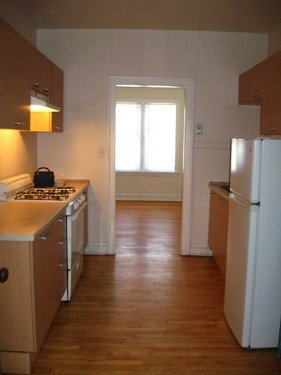 model kitchen with wood floors at 822-836 South Austin Apartments