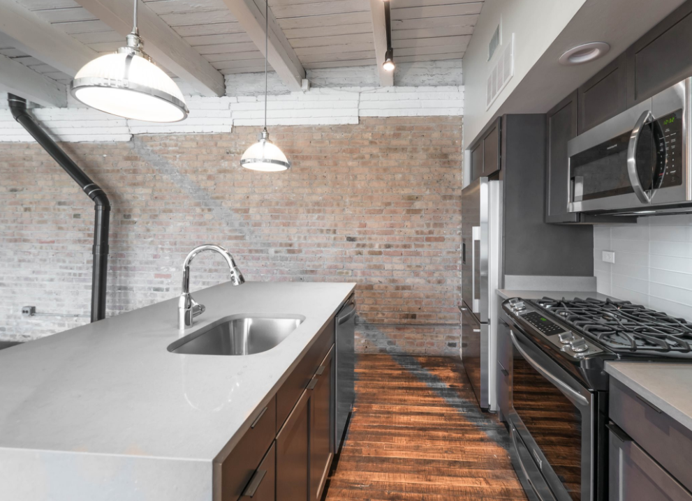 model kitchen with timber ceiling and brick wall- 1012 West Randolph Lofts