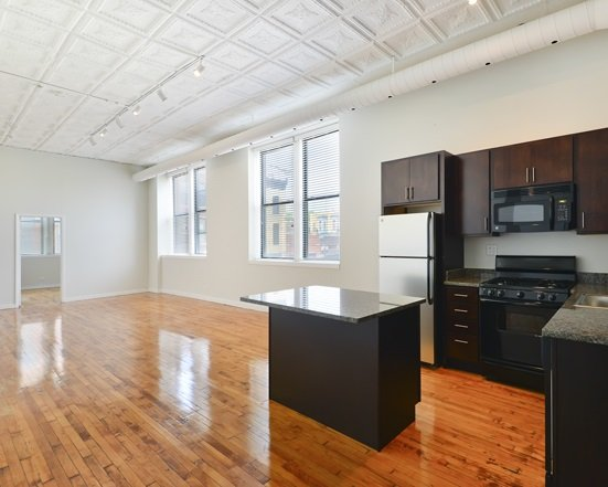 kitchen and living area at 1471 North Milwaukee Apartments  in Wicker Park