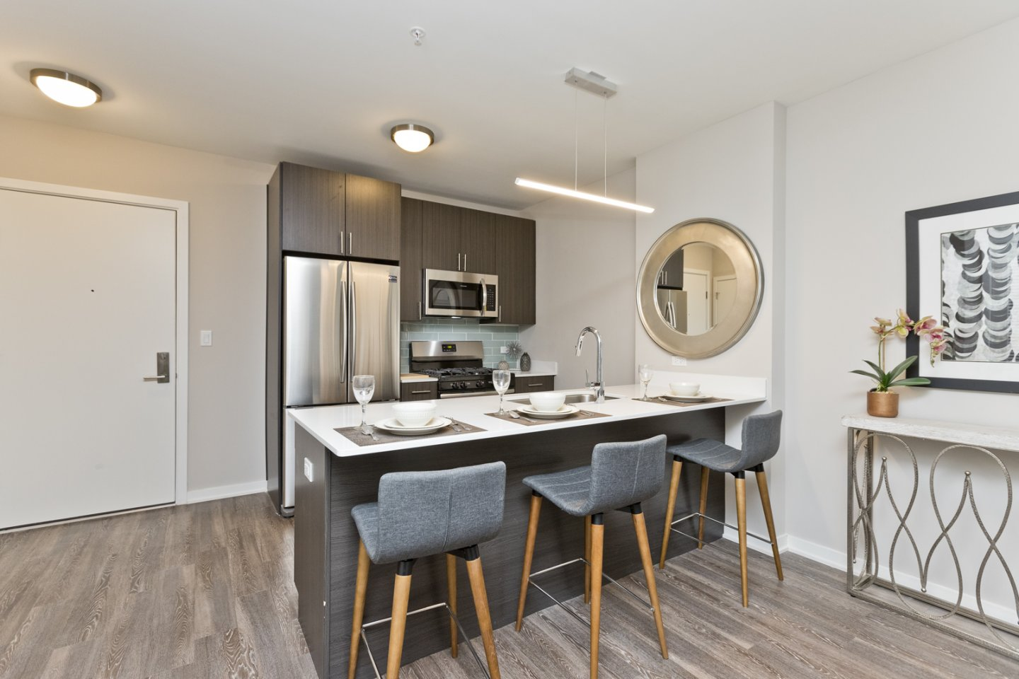 model unit kitchen island and wood floors at North Park Pointe Apartments