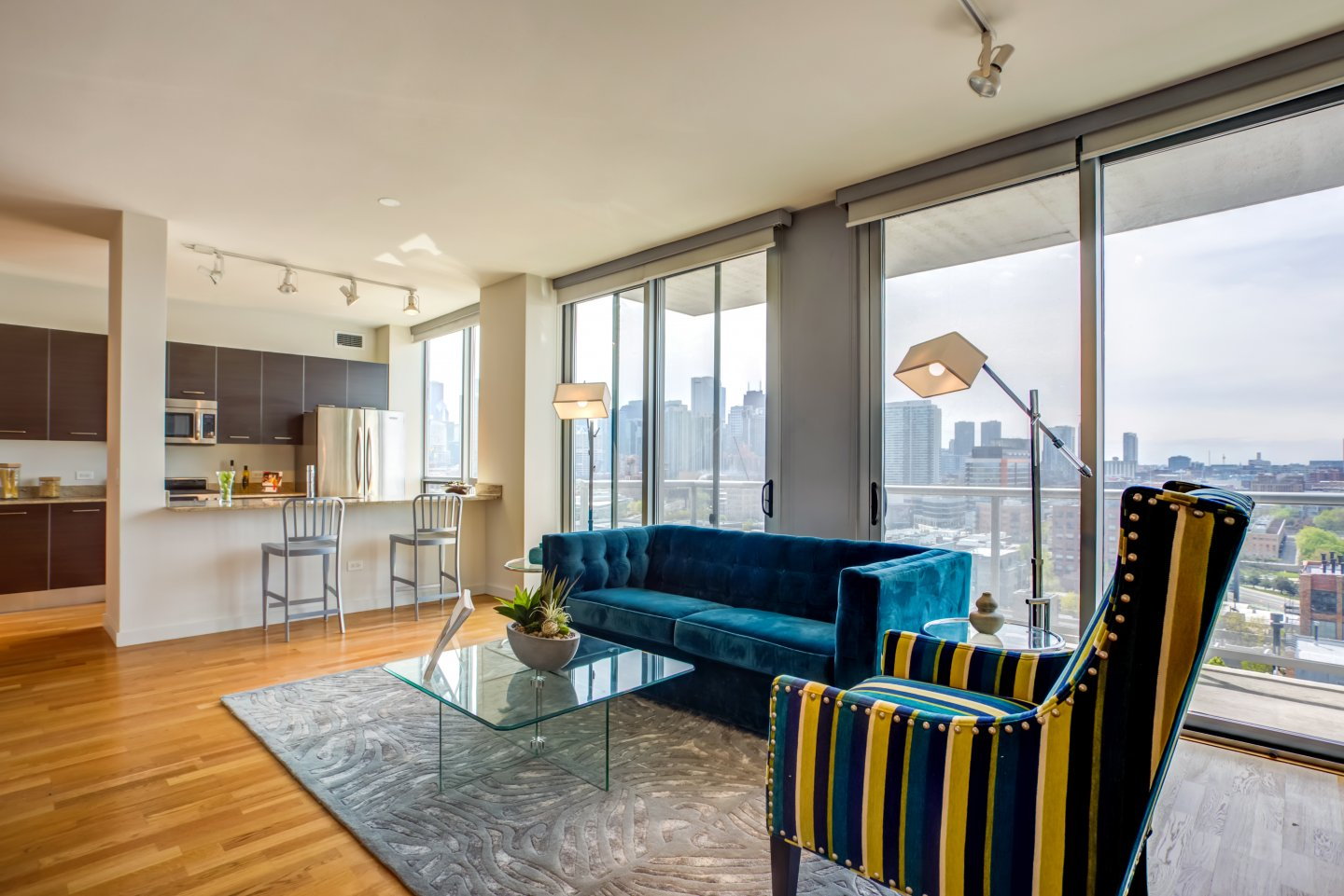 living room and view of chicago at Mondial River West Apartments