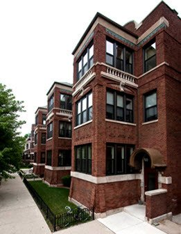 sidewalk view of red brick experior of 2319 North Kedzie Apartments