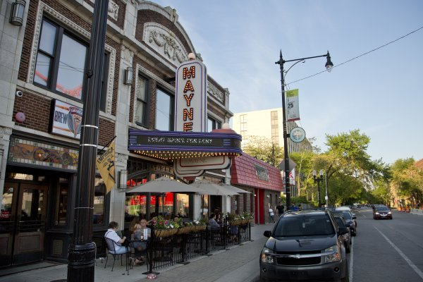 Mayne Stage marquee and outdoor patio seating on W Morse Ave in Rogers Park Chicago