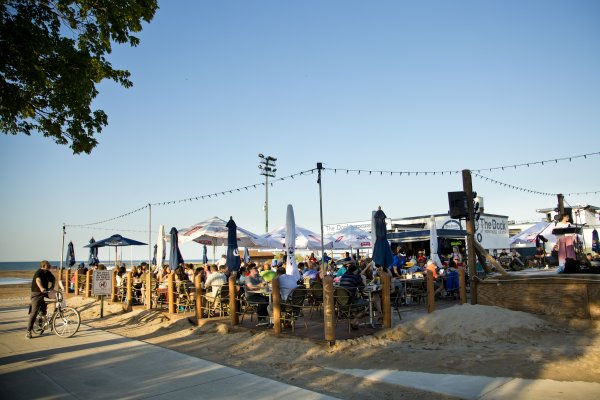 The Dock restaurant cafe with outdoor seating patio at Lake Michigan beach in Uptown