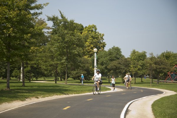 Cyclists and jogger lakefront path in Margate Park Chicago