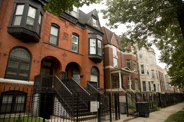 Historic apartment buildings and front yards in Bronzeville Chicago
